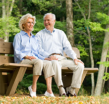 Couple relaxing on a bench.